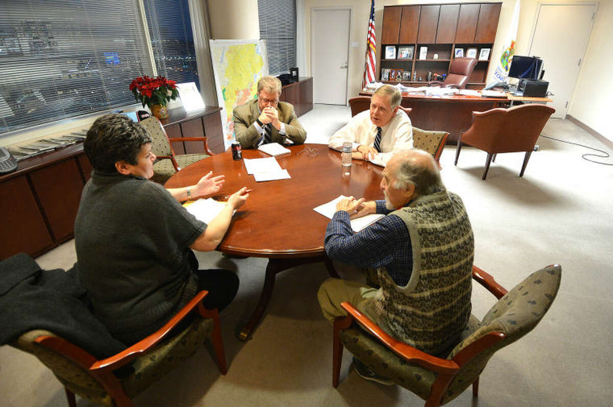 Mayor David Martin meets with Citizens Service Bureau Supervisor Frank Fedeli in the mayor's office during the first of what will be a monthly Mayors Night In initiative.