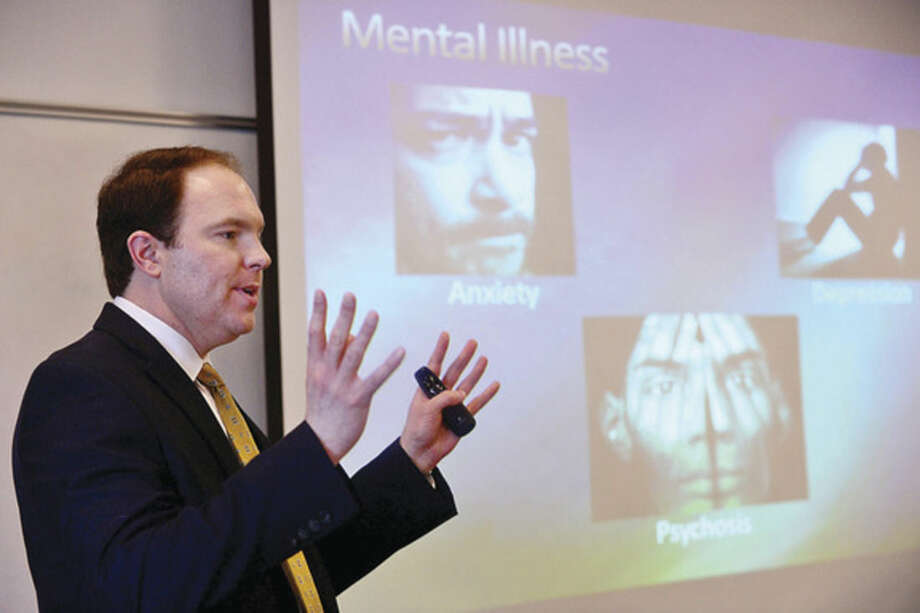"""Dr. John Douglas, Silver Hill Hospital clinical director of the Outpatient Addiction Program, talks about marijuana use during the presentation, """"Not My Kid: What's Really Happening with Marijuana, Binge Drinking, and E-Cigarettes in Wilton,"""" at the Wilton Library Tuesday morning."""