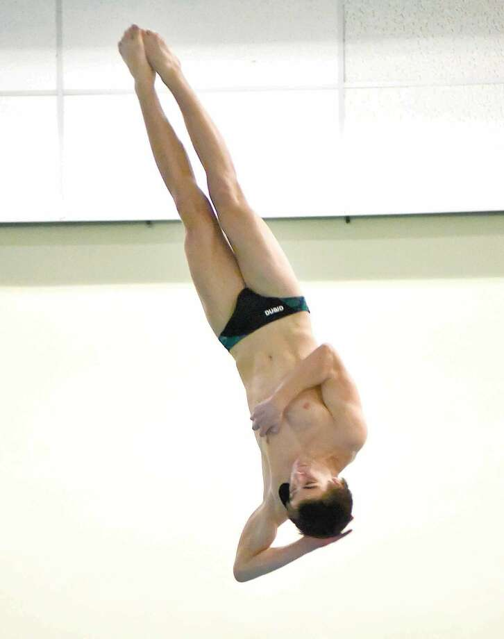 Hour photo/John Nash - Norwalk-McMahon's Kevin Bradley performs one of his 11 dives during Wednesday's FCIAC Diving championship meet at Westhill High School's pool in Stamford.