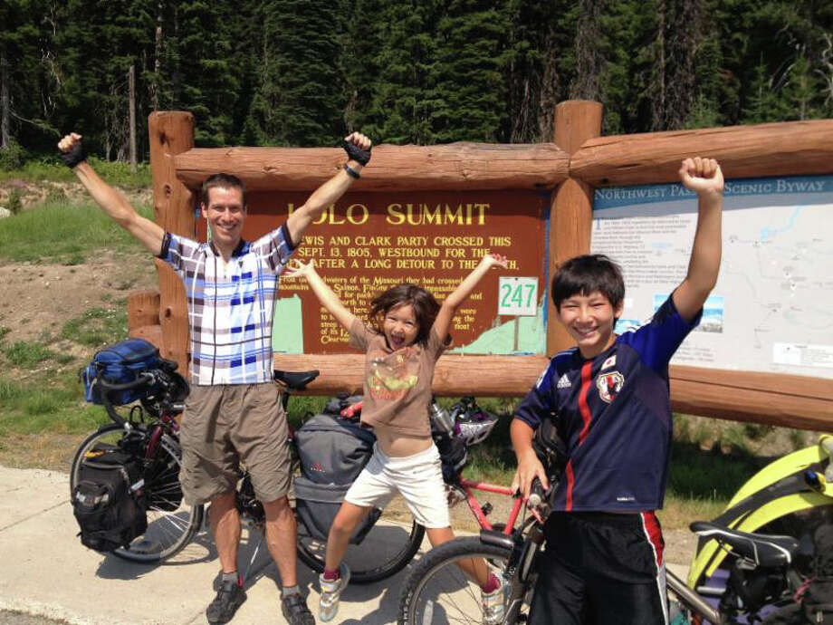 """Bicycle enthusiasts Charles Scott and his two children (Sho, then 12, and Saya, then 6) reach the highest point in their journey following the route taken by (Meriwether) Lewis and (William) Clark when they explored the West in the 1800s. Scott and his children share their adventures in """"Perceived Limits,"""" part of the Ciclismo Classico Bike Travel Film Festival at the Palace Danbury on Friday, June 17. Photo: Charles Scott / Contributed Photo"""