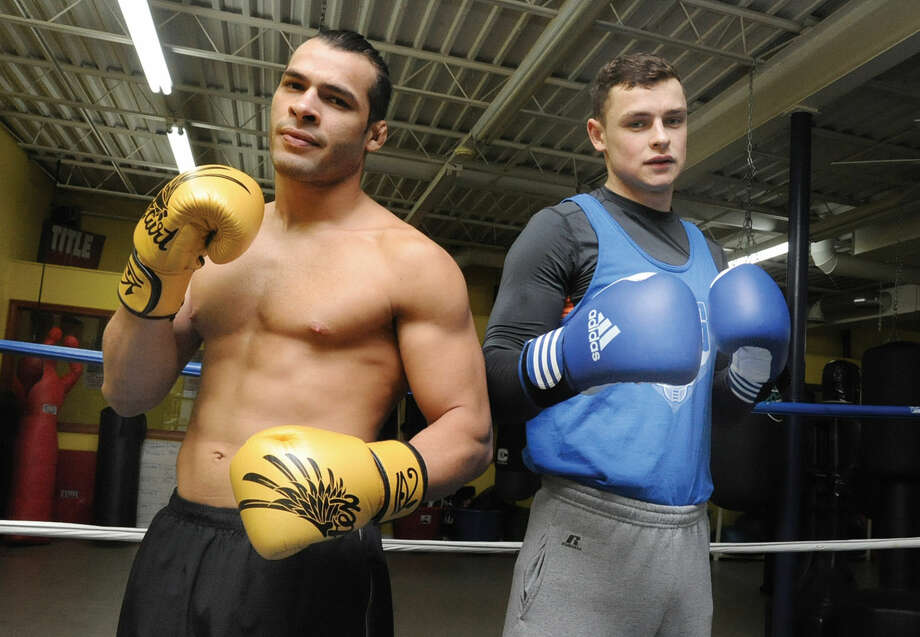 Vinicius De Jesus, left, and Ihor Laba, right, at Heavy Hitting Boxing and Fitness in Stamford. The two, both immigrants, are among the gym's best boxing prospects.