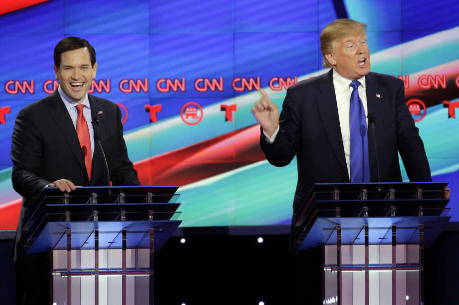 Republican presidential candidate, Sen. Marco Rubio, R-Fla., left, reacts as Republican presidential candidate, businessman Donald Trump speaks during a Republican presidential primary debate at The University of Houston, Thursday, Feb. 25, 2016, in Houston. (AP Photo/David J. Phillip)
