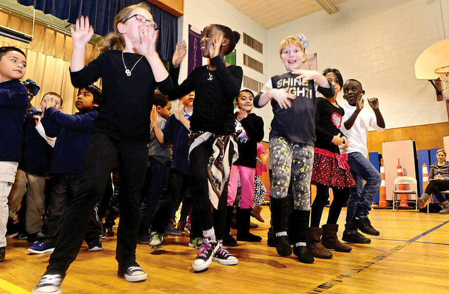 "Hour photo / Erik Trautmann Jefferson Science Magnet School first graders dance the Funga Alafia during the school's Black History Month event, titled ""Music for the Soul"" Thursday morning."