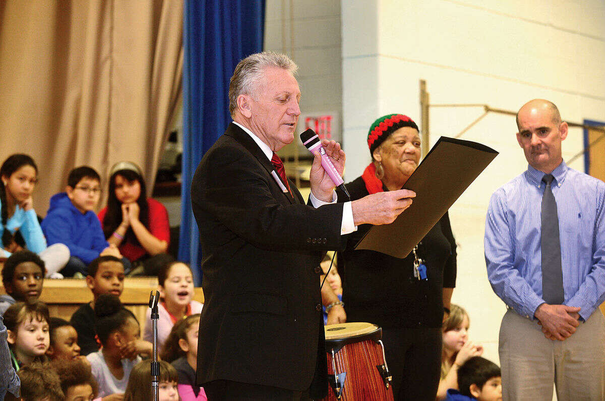 Hour photo / Erik Trautmann Norwalk Mayor Harry Rilling reads a proclamation as part of the Jefferson Science Magnet School Black History Month event, titled