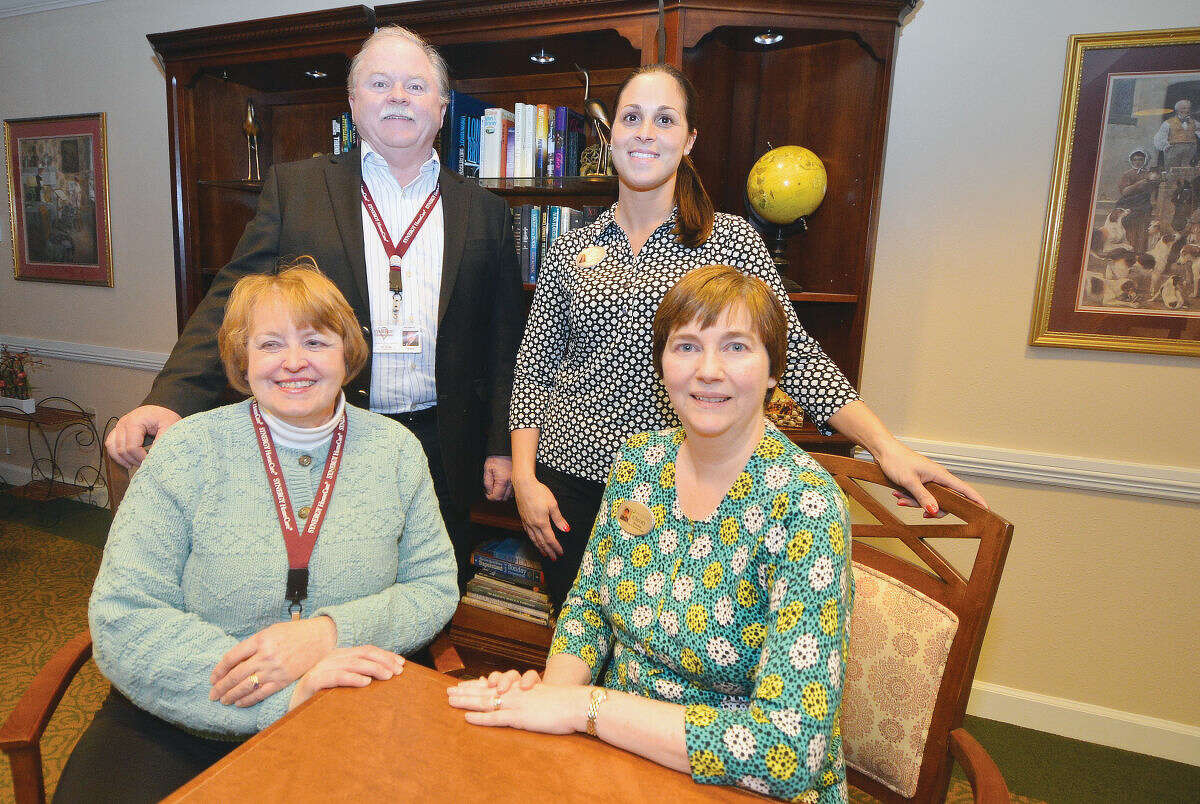 """Kay Schreiber and Jay Kiley with Synergy Home Care and Brookdale Wilton Senior Living Director April Gaudioso and Brookdale Sales and Marketing Manager Christy Perone help to promote a screening of the movie """"His Neighbor Phil."""""""