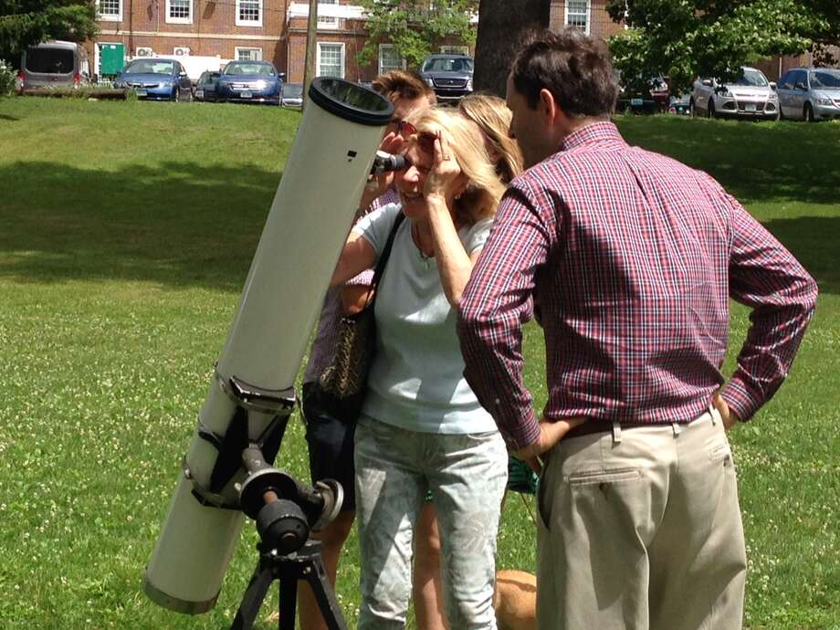A Summer Solstice celebration takes place on Father's Day, Sunday, June 19, at the Westport Library. Visitors will be able to safely look at the sun through telescopes. Photo: Westport Library / Contributed Photo
