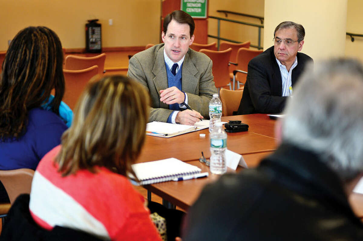 Congressman Jim Himes and The Workplace Executive Director Joe Carbone host a roundtable discussion on unemployment insurance and hears from out-of-work constituents on the importance of extending critical benefits at the Stamford Government Center Thursday.