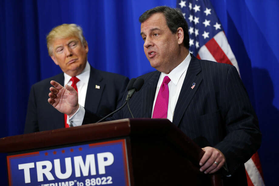 New Jersey Gov. Chris Christie, right, endorses Donald Trump, left, for president on Friday, Feb. 26, 2016, before a Trump rally at the Ft. Worth Convention Center in Ft. Worth, Texas. Christie backed Trump in the Republican race for president Friday, a powerhouse endorsement as the billionaire tries to beat back assaults on his character from a newly aggressive rival, Marco Rubio. (Tom Fox/The Dallas Morning News via AP)