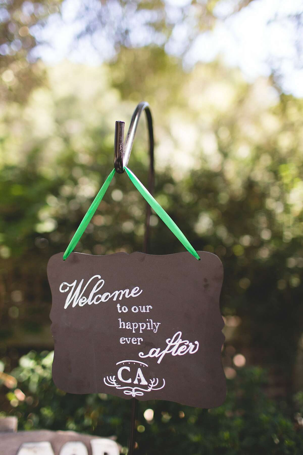 A sign welcomes guests to the wedding of Alia Al-Sharif and Cameron McDonald.