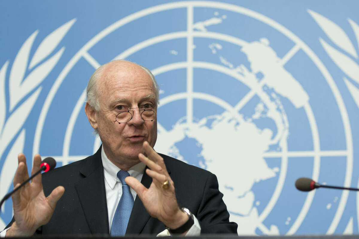 """Staffan de Mistura, UN Special Envoy of the Secretary-General for Syria, speaks during a press conference about the beginning of a cessation of hostilities in Syria and the next talks scheduled in Geneva between the government and the opposition, at the European headquarters of the United Nations, in Geneva, Switzerland, late Friday, Feb. 26, 2016. De Mistura plans to resume peace talks on March 7 if the cessation of hostilities coming into effect at midnight local time """"largely holds."""" (Martial Trezzini/Keystone via AP))"""