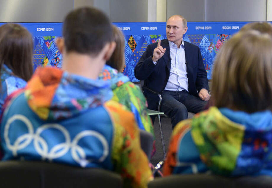 "FILE - In this Friday, Jan. 17, 2014 file photo, Russian President Vladimir Putin speaks during a meeting with Olympic volunteers in the Black Sea resort of Sochi, Russia. Putin said gays should feel welcome at the upcoming Winter Olympic Games in Sochi, but they must ""leave the children in peace."" Putin told volunteers Friday that gays visiting Sochi ""can feel calm and at ease,"" and vowed that there would be no discrimination at the games. But he emphasized that, according to a law banning homosexual ""propaganda"" among minors, gays cannot express their views on gay rights issues to anyone underage. (AP Photo/RIA-Novosti, Presidential Press Service, Alexei Nikolsky)"