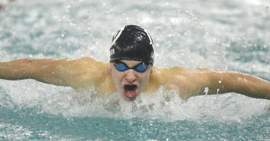 Wilton High boys swimmer Christian Larsen competes in the 100 butterfly during Friday's FCIAC Championship meet at Greenwich High.