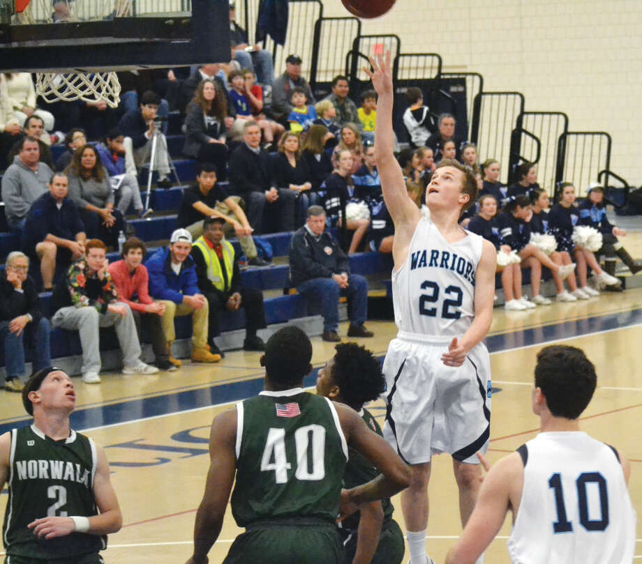 Wilton's Drew Connolly puts up a shot against Norwalk on Wednesday night. Connolly led the Warriors with 21 points.