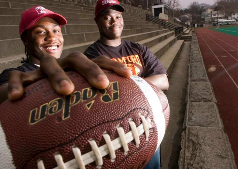 Stamford_012906_ Alex Joseph, left, and Vladimir Ducasse, right, signed with Temple University and UMass, respectively. They pose at Boyle Stadium at Stamford High School in Stamford, Conn. on Monday, Jan. 30, 2006. Chris Preovolos/Staff Photo Photo: CHRIS PREOVOLOS, ST / THE ADVOCATE