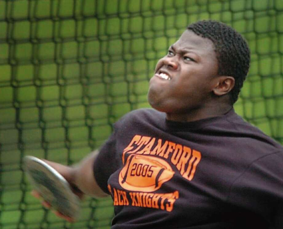 "Danbury_052206_FCIAC Track MEET: Stamford's Vladimir Ducasse  tosses a winning throw of 139'0"" in the ifnals of the boys discus. He also won the shot put. by Paul Desmarais/ Staff Photo: SPORTS Photo: ST"