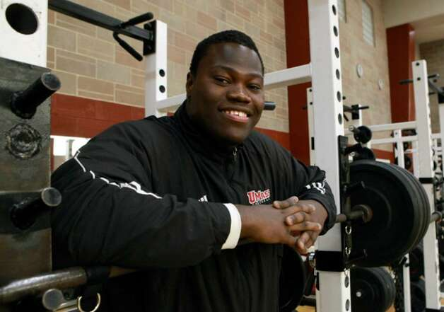 University of Massachusetts offensive tackle Vladimir Ducasse, originally from Haiti, poses for a photograph in a gym on the school's campus, in Amherst, Mass.,on  Friday, Jan. 22, 2010. Ducasse, who has lived in the United States since he was 14, is headed to the Senior Bowl college all-star football game with thoughts of impressing pro scouts, and concerns about his native Haiti. (AP Photo/Steven Senne) Photo: Steven Senne, AP / AP