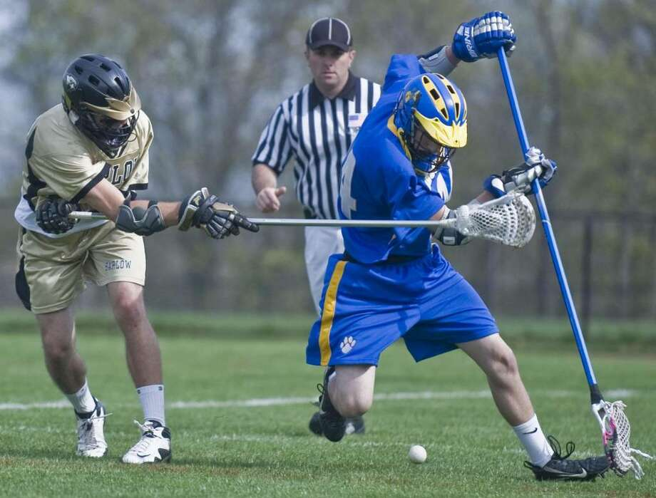 Barlow's Pat Eaker and Brookfield's Seth Kaltrider try to control the loose ball during a boys lacrosse game at Barlow. Wednesday, April 21, 2010 Photo: Scott Mullin