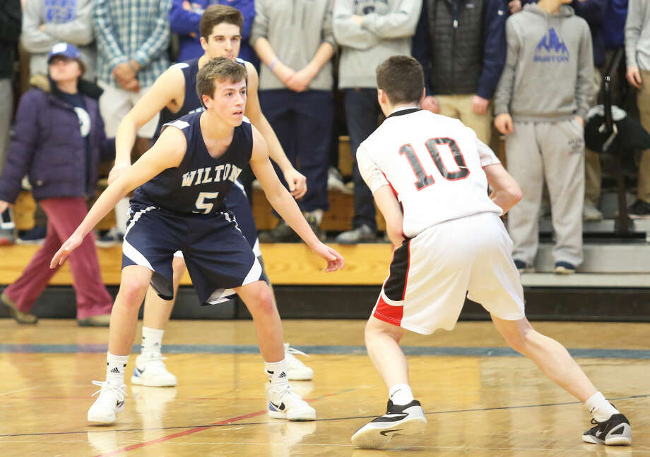 Wilton's #5, Sean Breslin, plays defense during an FCIAC playoff game against Fairfield Warde at Fairfield Ludlowe High School Saturday evening.