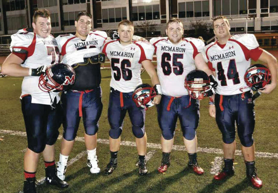 Former McMahon standout lineman Andrew Starr, left, will play college football at Sacred Heart University.