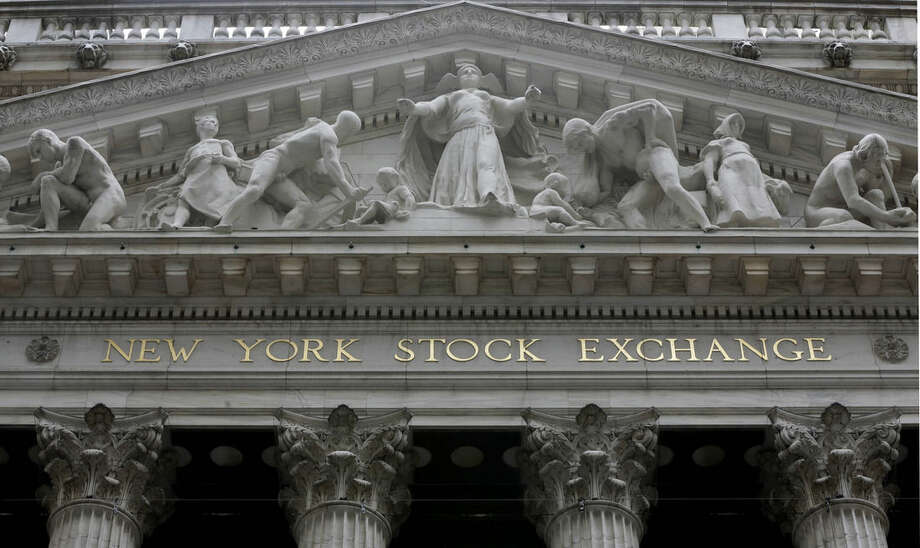 FILE - This Oct. 4, 2014, file photo, shows the facade of the New York Stock Exchange. Global markets meandered Thursday, Dec. 24, 2015, despite earlier gains in Asia and as the surge in oil prices faded in light Christmas Eve trading. (AP Photo/Richard Drew, File)