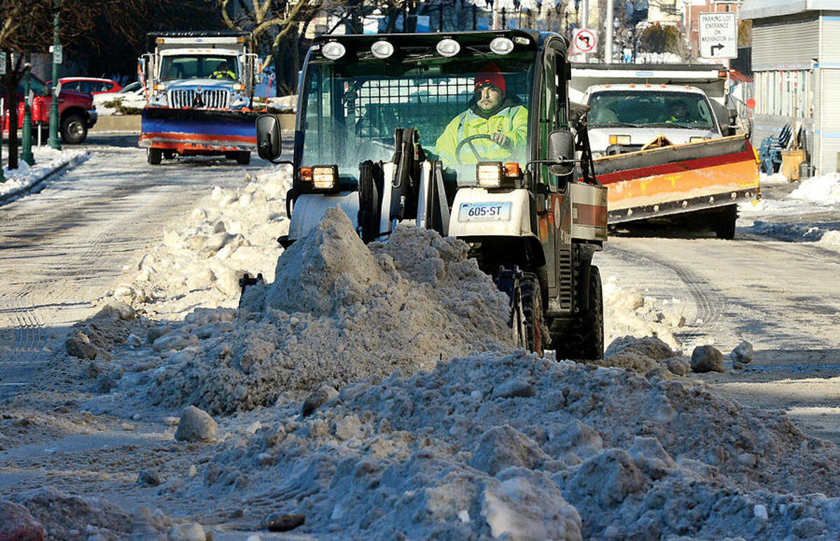 Hour photo / Erik Trautmann The City of Stamford Department of Operations conducts snow removal operations in the downtown area Wednesday to clear blockages and allow for more convenient travel for both vehicles and pedestrians. Affected streets; Main Street between Washington Blvd. and Atlantic Street, West Park Place, Bank Street, Bedford Street between Broad Street and Walton Place were closed while cleaning occurred.