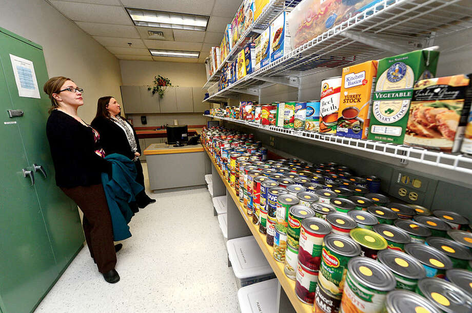Hour photo / Erik Trautmann Norwalk Community College Service Learning Coordinator, Courtney Anstett, gives a tour of the college's new food pantry for students to Kaytee Stewart, CT Campus Compact program coordinator, Wednesday morning following a a ribbon cutting ceremony.