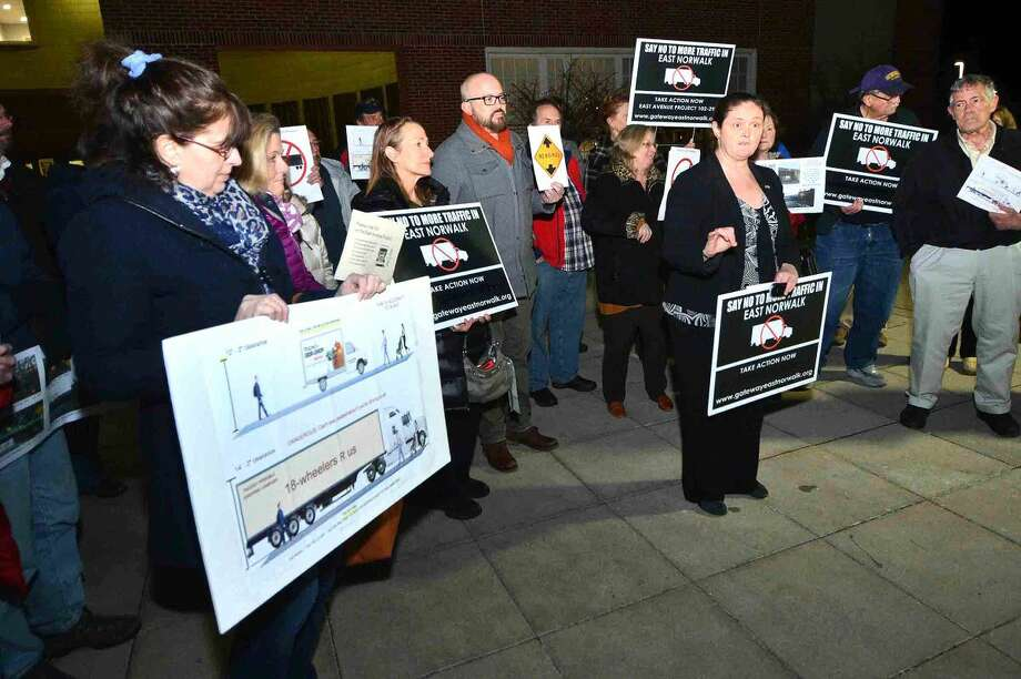 Hour Photo/Alex von Kleydorff. In front of City Hall, Debora Goldstein and area residents speak their mind and oppose the heigtening work to be done on the Metro North Rail bridge over East Ave