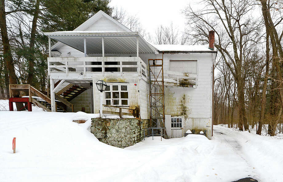 Hour photo / Erik Trautmann Conservation Commission may votes on wetlands permit for proposed development for former White Barn Theater property.