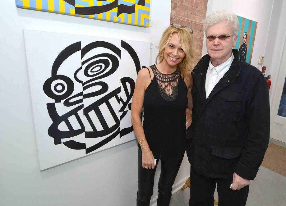 Hour Photo/Alex von Kleydorff Gallery owner Cabell Molina with artist Frank Foster Post at one of his pieces at the opening of the new Love Art gallery and Studio in SONO