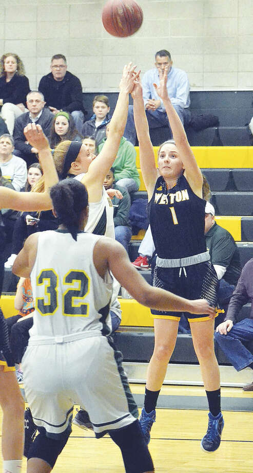 Hour photo/Pete PaguagaWeston's Katie Orefice goes up for a shot against Holy Cross on Thursday night.
