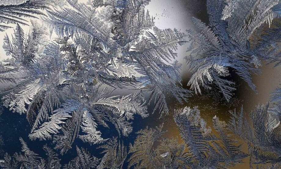 Hour Photo/Alex von Kleydorff Frost forms in patterns on a glass door during extreme cold weather in the region.