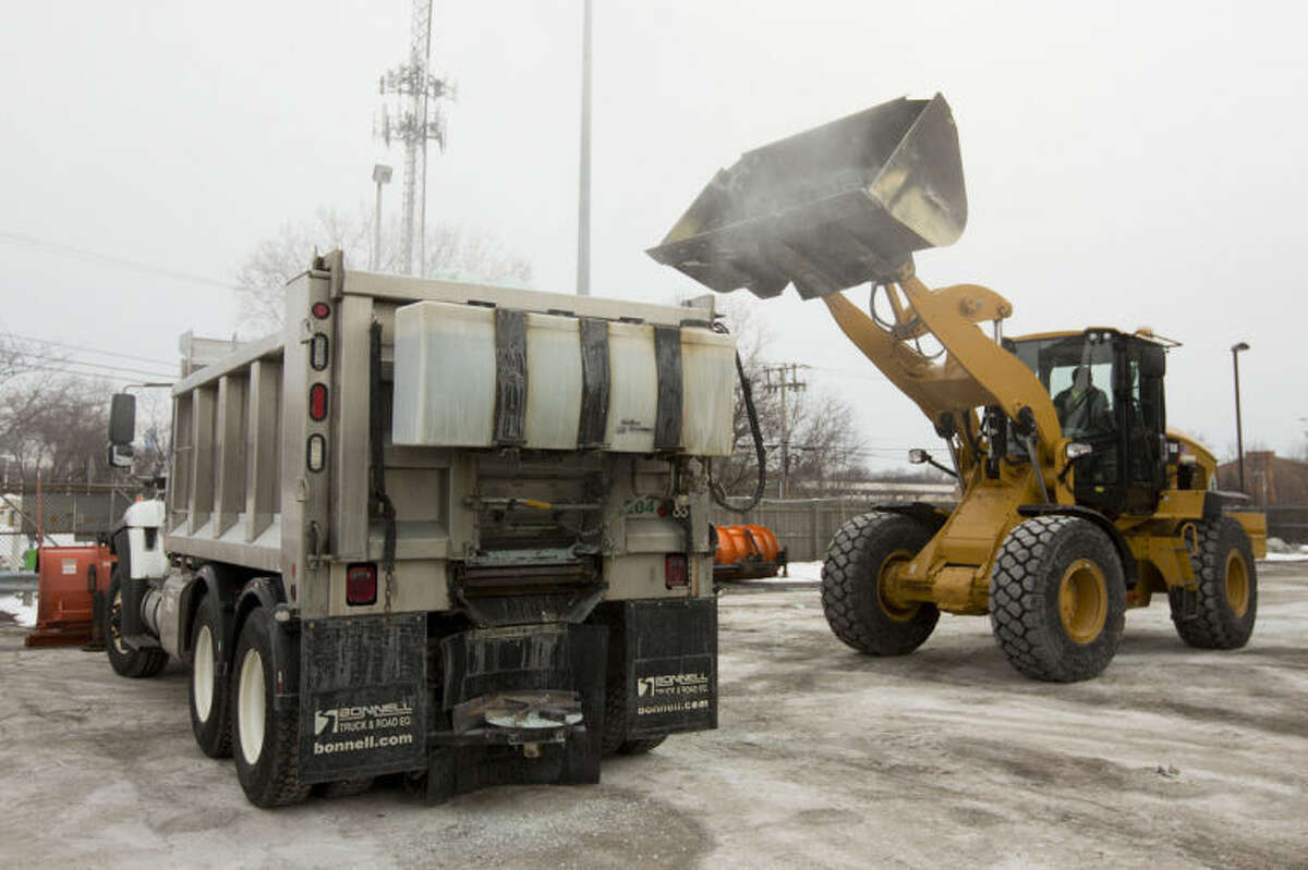Road salt is loaded into a snow plow truck equipped with a salt spreader at the public works facility in Glen Ellyn, Ill., on Tuesday, Feb. 4, 2014. The Midwest's recent severe winter weather has caused communities to expend large amounts of their road salt supplies. (AP Photo/Andrew A. Nelles)