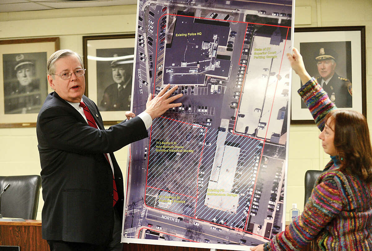 Hour photo / Erik Trautmann Stamford mayor David Martin announces the plan to build a new police headquarters on the historic Hoyt Barnum property next door during a news conference Thursday at the existing police headquarters which is presently dealing with asbestos issue.