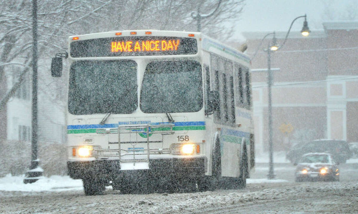 Hour Photo/Alex von Kleydorff . A Norwalk Wheels bus makes its rounds during heavy snowfall