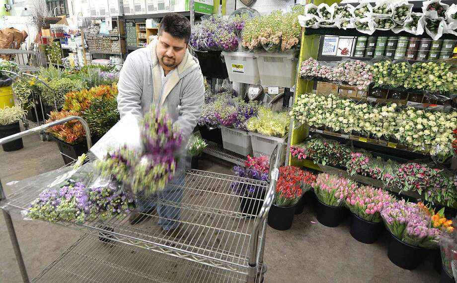 Hour Photo/Alex von Kleydorff Jamal Ansari, Senior Vice President of Operations starts to fill a flower order for a client at East Coast Wholesale Florist in Norwalk