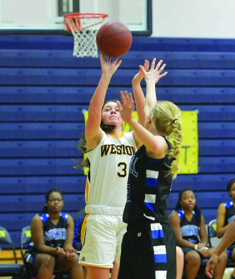 Weston's Claire Levi goes up for a shot. (Hour Photo/Alex von Kleydorff. )