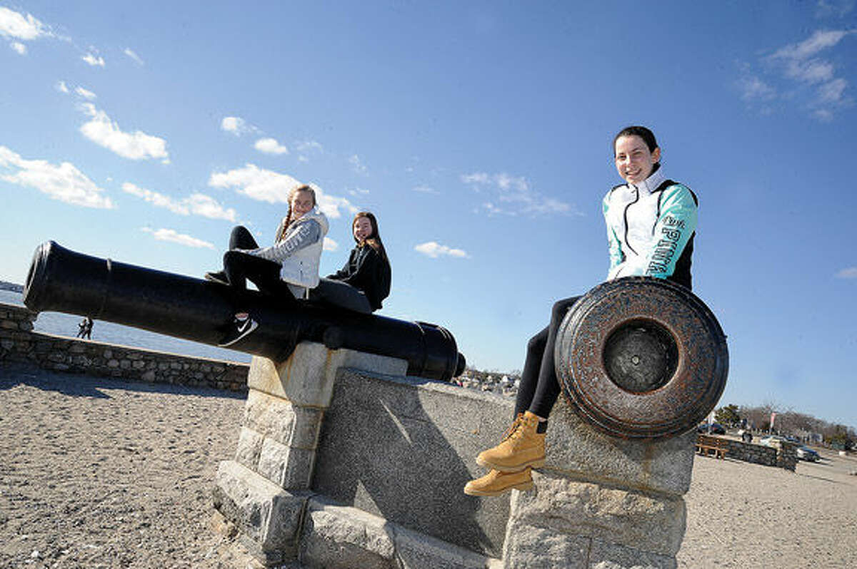 Freinds Kathleen Cozzi, Tess Jacobs and Masie Dembski all 13 getting some sun Monday afternoon on the cannons near the Compo Beach shoreline in Westport. Hour photo/Matthew Vinci