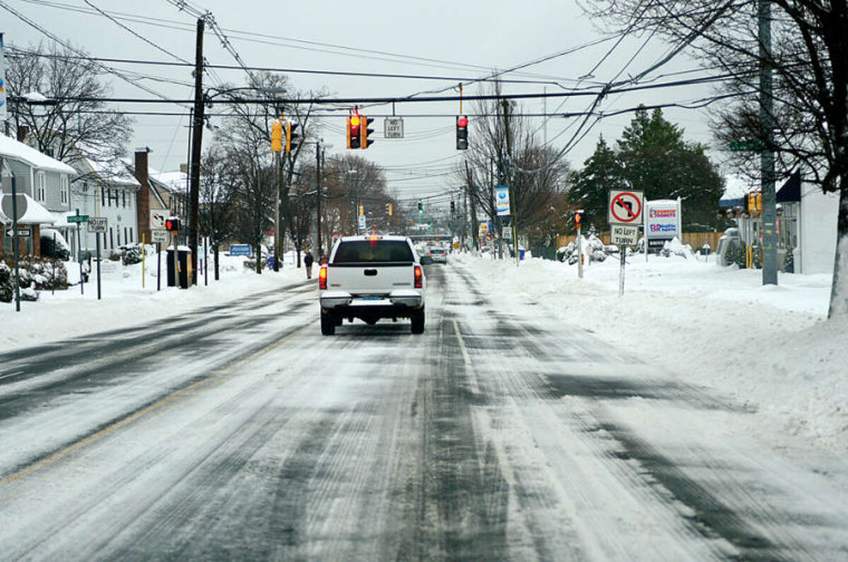 Hour photo / Erik Trautmann Local roads are clearing but are still slippery following the recent snowfall that left 5 inches of wet snow for commuters to deal with Wednesday morning.