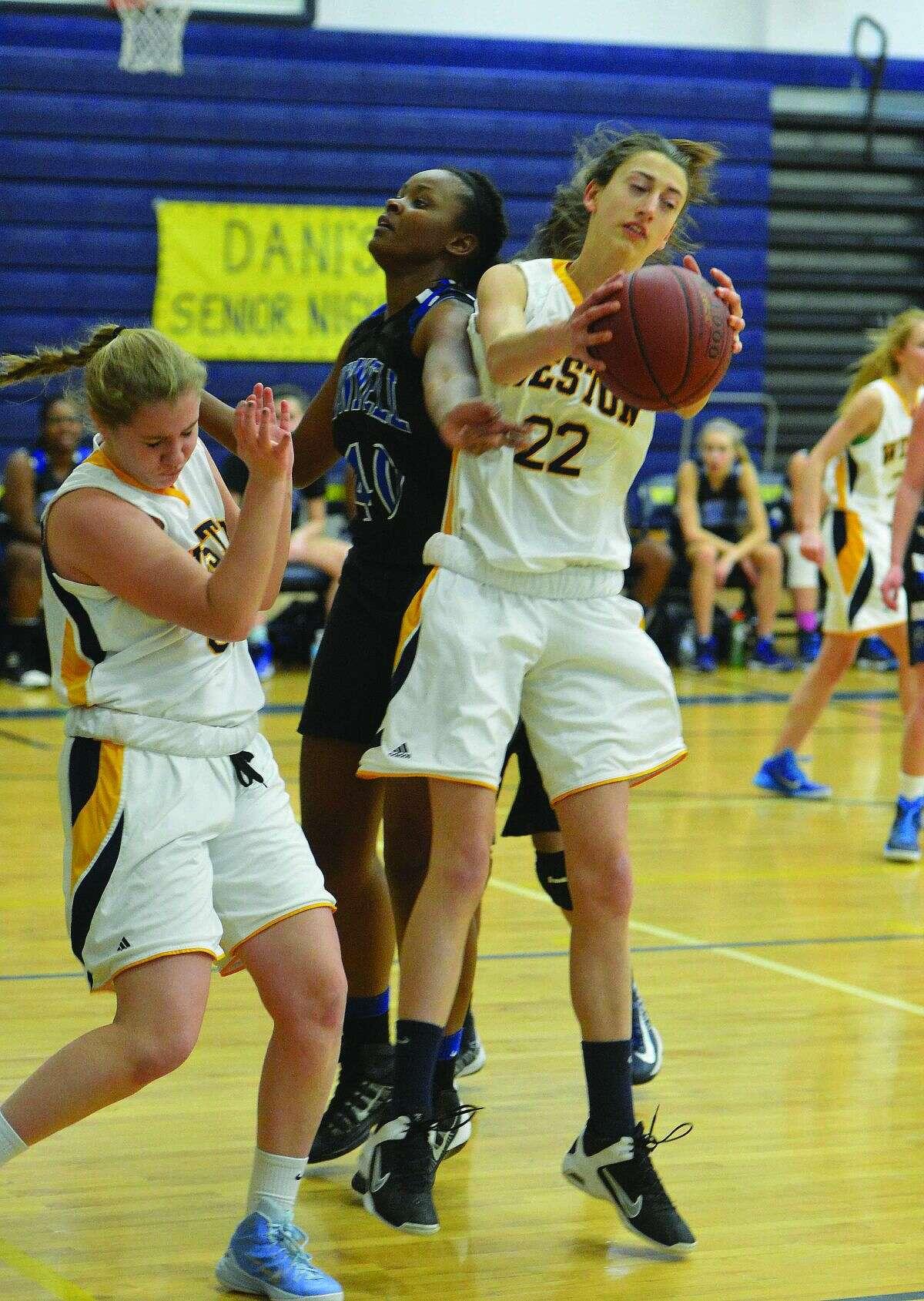 Weston's Bridget Mahony grabs a rebound. (Hour Photo/Alex von Kleydorff.)