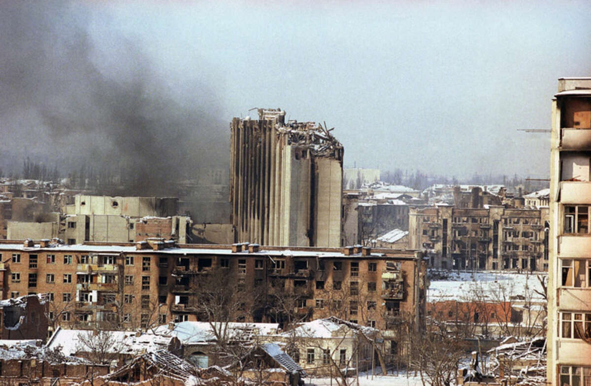 FILE - This Jan. 21, 1995 file photo shows a side view of the smoking Presidential Palace which stands out amid the devastation in the center of Grozny, Chechnya, Russia. During Russia's wars against separatists in Chechnya, the armed forces first attacked Grozny, the capital, in late 1994 and early 1995 in what at the time was considered to be the heaviest bombing campaign in Europe since the end of World War II. (AP Photo/Peter Dejong, File)