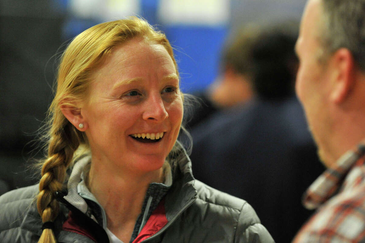 New Canaan girls lacrosse coach Kristin Woods speaks with the media during the FCIAC Lacrosse Kickoff Night at Bluestreak Sports Training in Stamford, Conn., on Thursday, March 27, 2014.