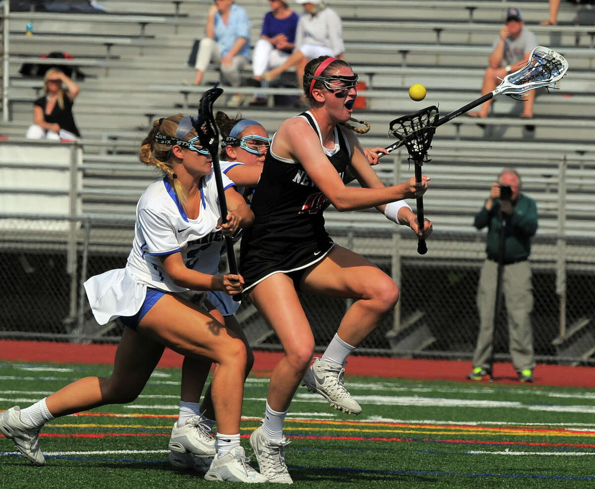 New Canaan Samantha Stewart loses the ball on her drive against Darien Katherine Heaney in a FCIAC Girls Lacrosse Final at Brien McMahon High School in Norwalk, Conn. on May 26, 2016. Darien defeated New Canaan 12-11 in over-time.