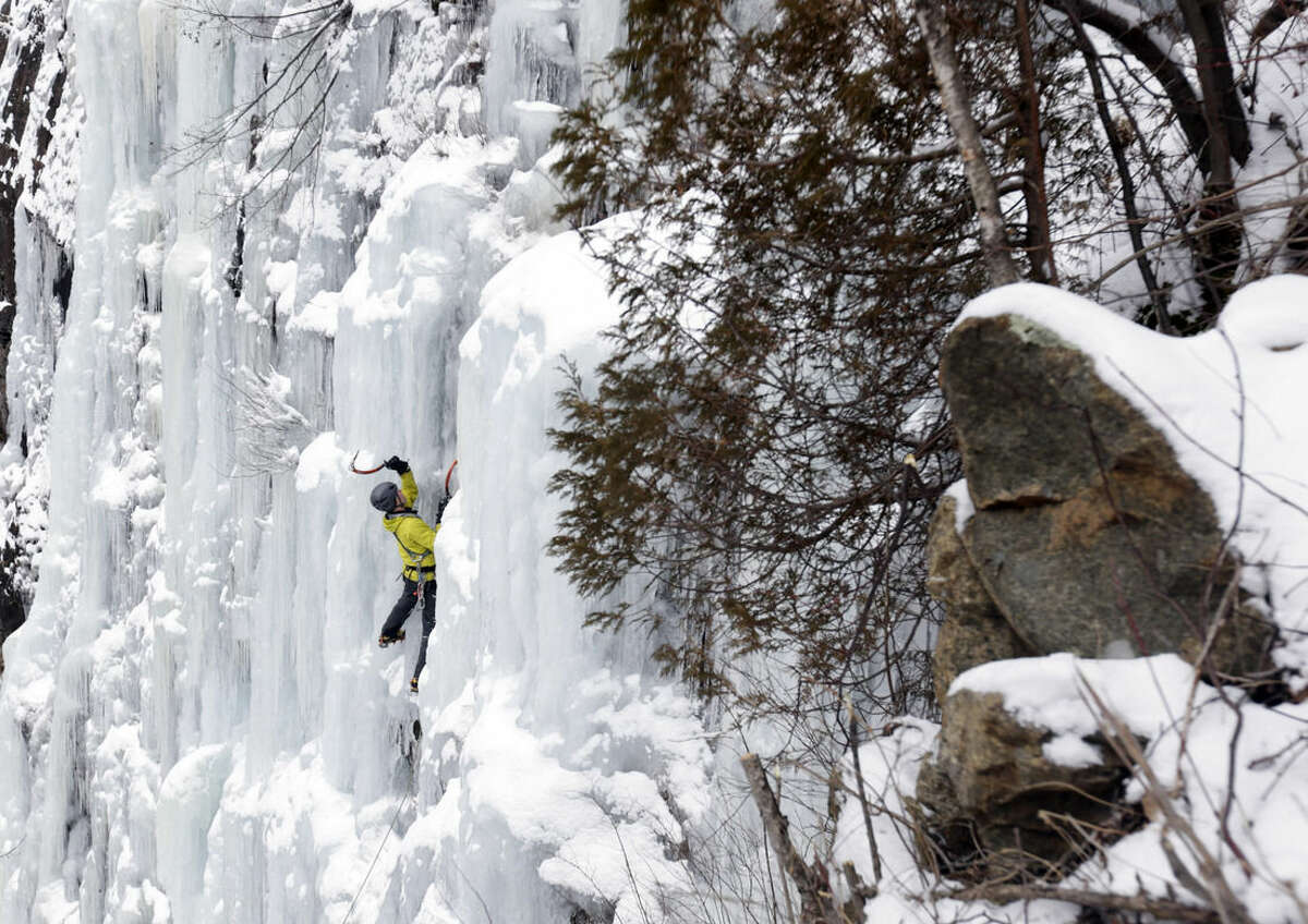 In this Wednesday, Feb. 10, 2016 photo, ice climber Don Mellor climbs Pitchoff Quarry in Keene, N.Y. Mellor began ice climbing in the make-your-own tools era and has since introduced the sport to generations of students at a Lake Placid prep school where he is a teacher and counselor. He wrote the book, literally, on ice climbing in this rugged region. (AP Photo/Mike Groll)