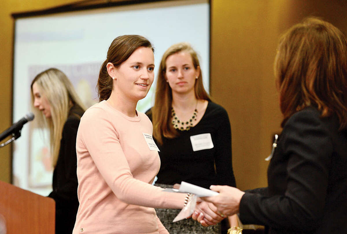 Hour photo / Erik Trautmann Megan and Meredith Donaher of Gault Energy and Stone accept their The Business Council of Fairfield CountyHealthy Workplace Employer Recognition Award Friday at the Sheraton Stamford Hotel.