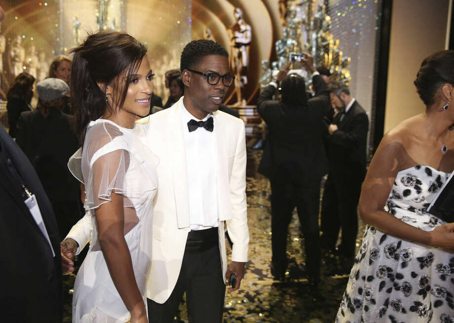 Megalyn Echikunwoke, left, and Chris Rock appear backstage at the Oscars on Sunday, Feb. 28, 2016, at the Dolby Theatre in Los Angeles. (Photo by Matt Sayles/Invision/AP)
