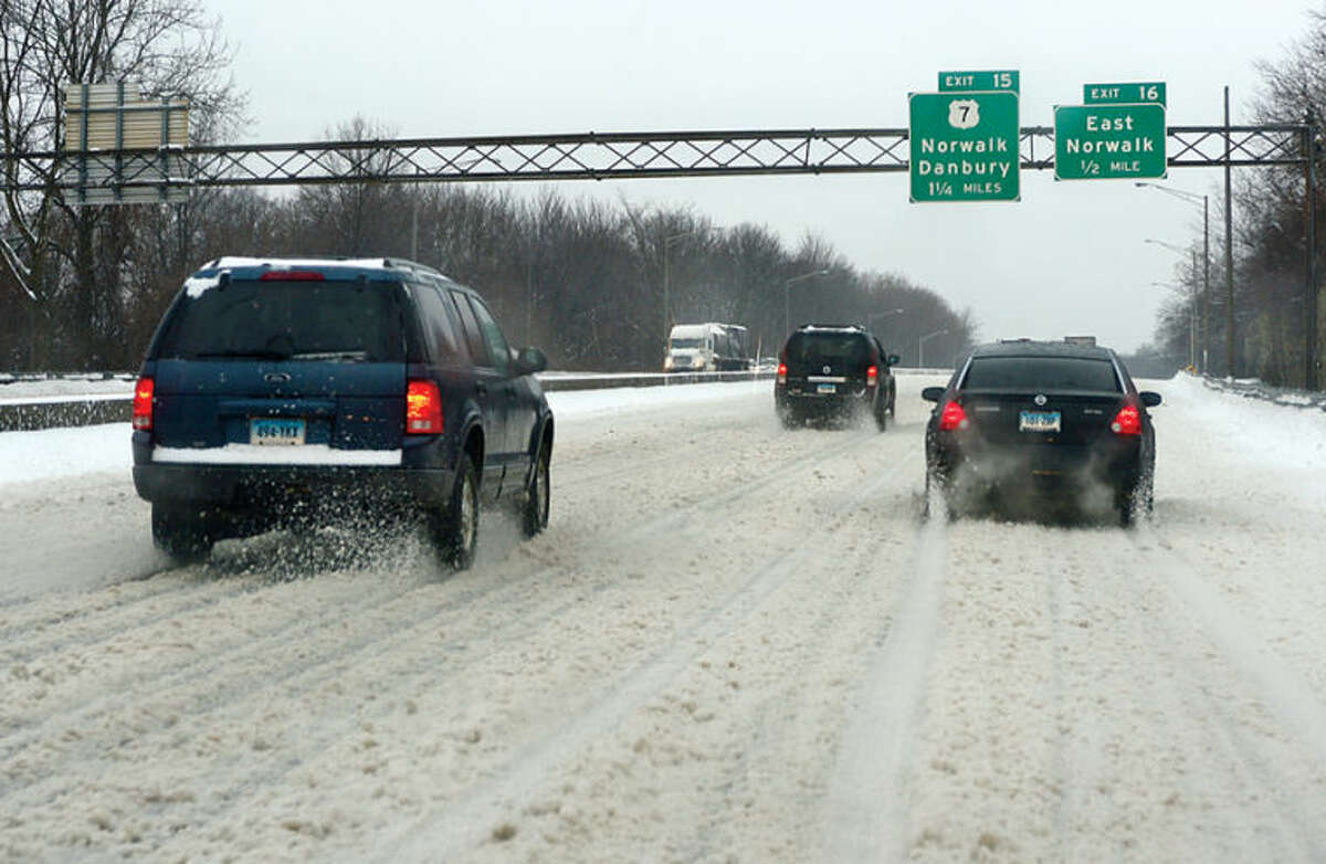 Hour photo / Erik Trautmann Local roads are clearing but still slippery following the recent snowfall that left 5 inches of wet snow for commuters to deal with Wednesday morning.