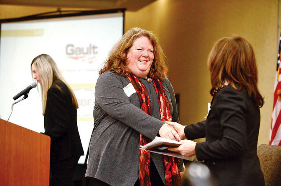 Hour photo / Erik Trautmann Smith of Stepping Stone Children's Museum for Children accepts the museum's Business Council of Fairfield County Healthy Workplace Employer Recognition Award Friday morning at the Sheraton Stamford Hotel.
