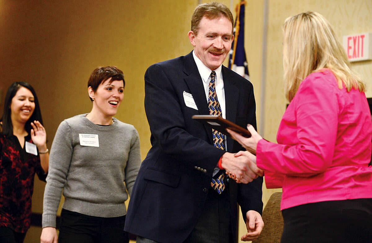 Hour photo / Erik Trautmann Walter Watson accepts the Platinum Business Council of Fairfield County Healthy Workplace Employer Recognition Award Friday morning at the Sheraton Stamford Hotel.