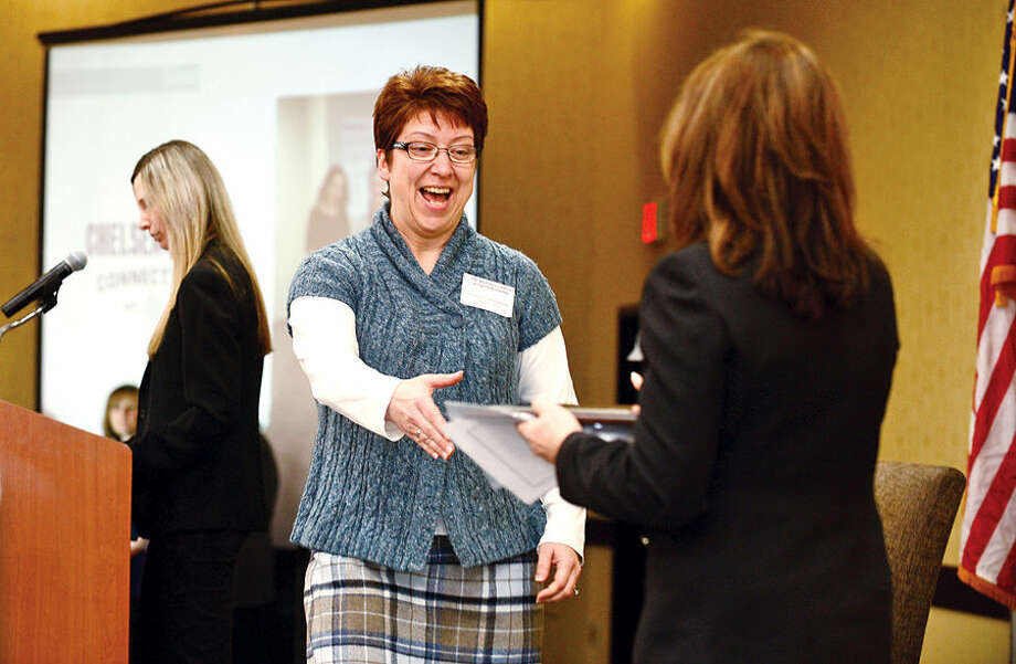 Hour photo / Erik Trautmann Priceline Diana Champagne accepts a Business Council of Fairfield County Healthy Workplace Employer Recognition Award Friday at the Sheraton Stamford Hotel.