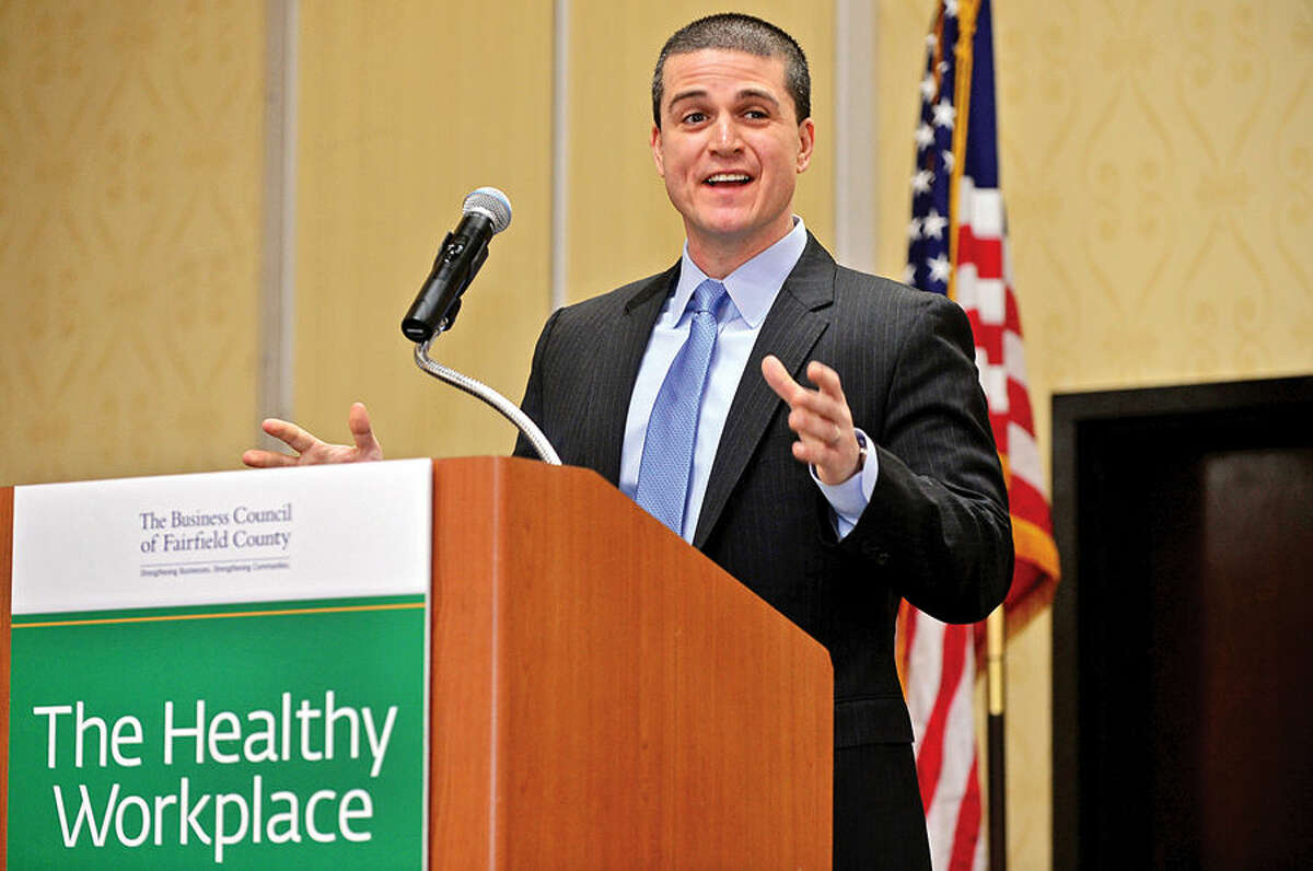 Hour photo / Erik Trautmann Matthew Fair, Regional Sales Director at First Niagra Risk Management speaks during The Business Council of Fairfield County Healthy Workplace Employer Recognition Program on Friday at the Sheraton Stamford Hotel.